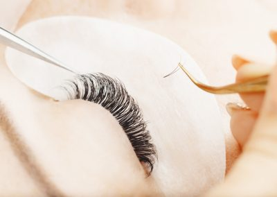 Eyelashes extensions. Eyelash extension procedure in spa beauty